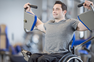 Man in wheelchair at lifting weights