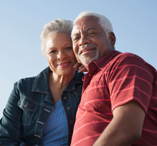 Older couple outdoors, smiling