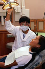 Picture of a young girl during a visit to her dentist