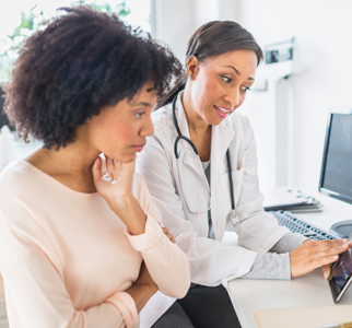 Female doctor talking with female patient